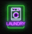 neon glowing laundry signboard on dark brick wall vector image vector image