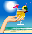 womans hand holding a fruit cocktail against the vector image