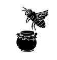 black silhouette of bee and honey glass jar