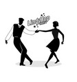 Lindy hop party young hipster couple dancing