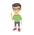 caucasian little boy showing victory gesture vector image vector image