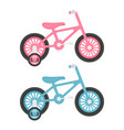 set of two pink and blue kids bicycles isolated on vector image vector image