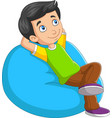 cartoon little boy relaxing on sofa vector image