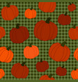 pumpkin patch seamless pattern with green plaid vector image vector image