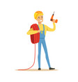 smiling electrician in uniform holding a wire roll vector image vector image