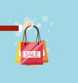 hand with shopping bag flat design vector image vector image