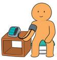 Man using blood pressure monitor