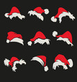 santa claus hats set on a black background vector image