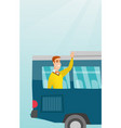 young caucasian man waving hand from bus window vector image vector image