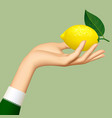 womans hand with a lemon isolated on green vector image vector image