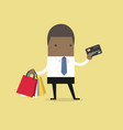 businessman with credit card and shopping bags vector image vector image