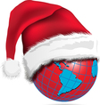 red globe in a christmas hat vector image