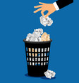 businessman hand put paper in trash vector image vector image