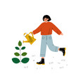 girl watering plant with watering can young woman vector image vector image
