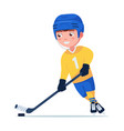 hockey player plays with a stick and puck vector image vector image