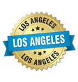 Los Angeles round golden badge with blue ribbon vector image vector image