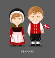 danes in national dress with a flag vector image vector image