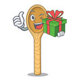 with gift wooden spoon mascot cartoon vector image