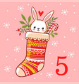 the hare is sitting in a christmas sock vector image vector image
