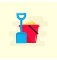 Bucket and spade with sand icon vector image