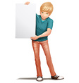 A handsome man holding an empty board vector image vector image
