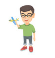caucasian cheerful boy playing with a toy airplane vector image vector image