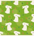 easter bunny on the grass vector image vector image