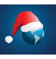 Planet earth with santa hat vector image vector image