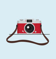 red vintage camera with camera strap vector image vector image