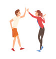 young man and woman giving high five to each other vector image vector image