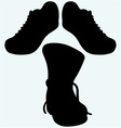 Old dirty boots and sneakers sport shoes vector image