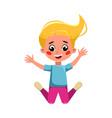 beautiful blonde girl happily jumping cute