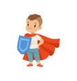 cute brave little boy character in red cape vector image vector image