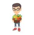 boy holding basket with fruit and vegetables vector image vector image