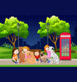 group of children and dogs in park vector image vector image