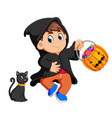 cute kid witch walking in black cloak vector image vector image