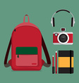 Red backpack with multiple items vector image