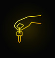 hand holding car key yellow icon vector image vector image