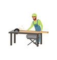 male professional carpenter in uniform cutting a vector image vector image