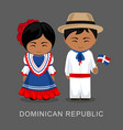dominicans in national dress with a flag vector image vector image