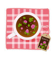 cup with tea clover flowers on a napkin view vector image vector image
