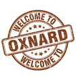 welcome to oxnard brown round vintage stamp vector image vector image