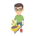boy pushing wheelbarrow with soil and plant vector image vector image