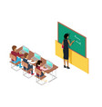 teacher writing on blackboard and pupils at desks vector image vector image