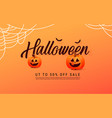 happy halloween calligraphy with pumpkins vector image