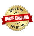 made in North Carolina gold badge with red ribbon vector image vector image