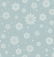 Seamless pattern of snowflakes on a blue vector image
