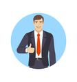 Smiling businessman shows thumb up