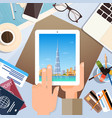 hand hold tablet computer with dubai skyline vector image vector image