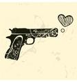 Love gun Vintage emblem with gun shooting a heart vector image